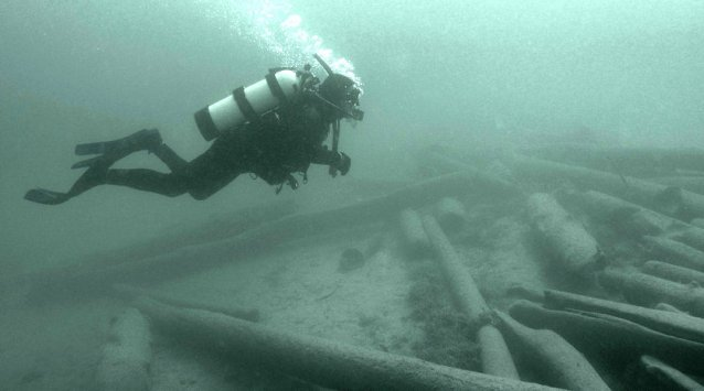 Diving to retrieve sunken timber from the log drive