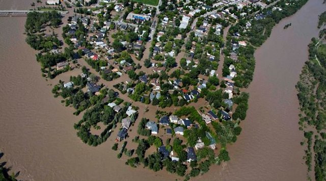 Flooded community in Alberta via Calgary Sun
