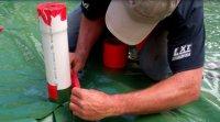 Installing a radon evacuation stack in a slab floor