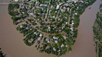 Flooded community in Alberta via Calgary Sun