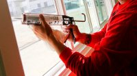 Caulking around windows is a cheap way to save a lot of money and energy