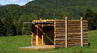 A tiny house that looks like a stack of logs