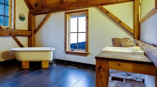 Recycled barn beams and a refinished clawfoot bathtub