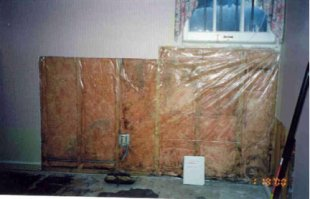 A rotting basement wall due to moisture sealed in by a polyethylene vapour barri