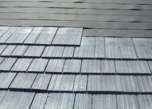 Choosing between different roofing materials green home for Synthetic roofing materials