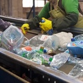 Sorting home recyclable materials at a recycling center