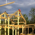 Timber frame home being raised
