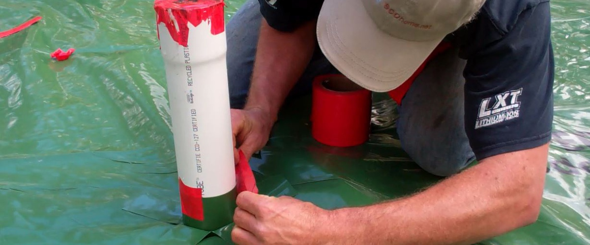 Installing a radon evacuation stack in a slab floor
