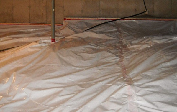 Crawlspace radon barrier installation