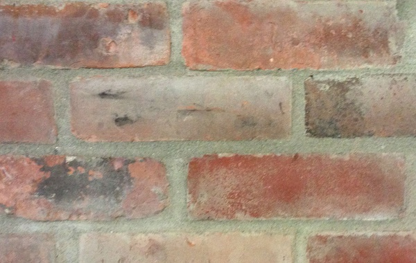 Repainting and refinishing brick facades