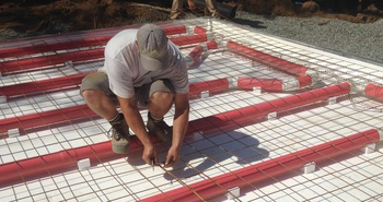 Air-heated radiant concrete floor