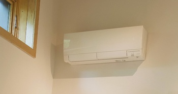 Ductless mini-split air source heat pump installed in a LEED certified PH Home