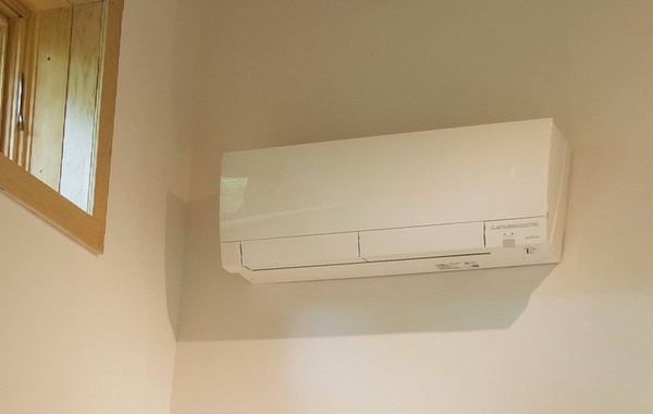 Ductless mini-split air source heat pump