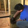 Installing soundproofing batts in interior partition walls