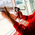 Caulking around windows is a cheap way to save a lot of money and ener