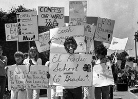 April 22, 1970: Sixth-grader Brad Frank, 11, wearing a gas mask, joins about 100 classmates during an Earth Day march on Wilshire Boulevard. (George Fry / Los Angeles Times)