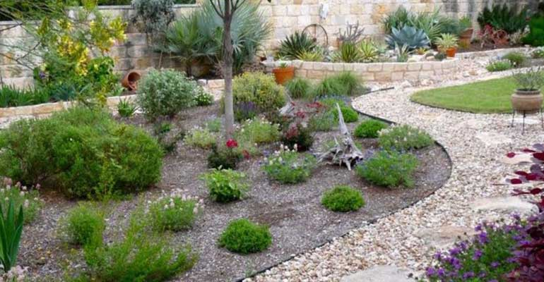 xeriscaping or native perennial beds as a lawn alternative