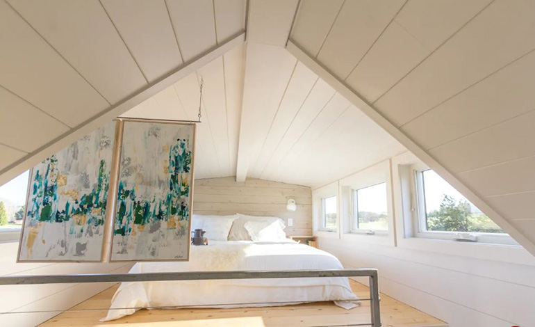 Natural light in spacious tiny House loft bedroom