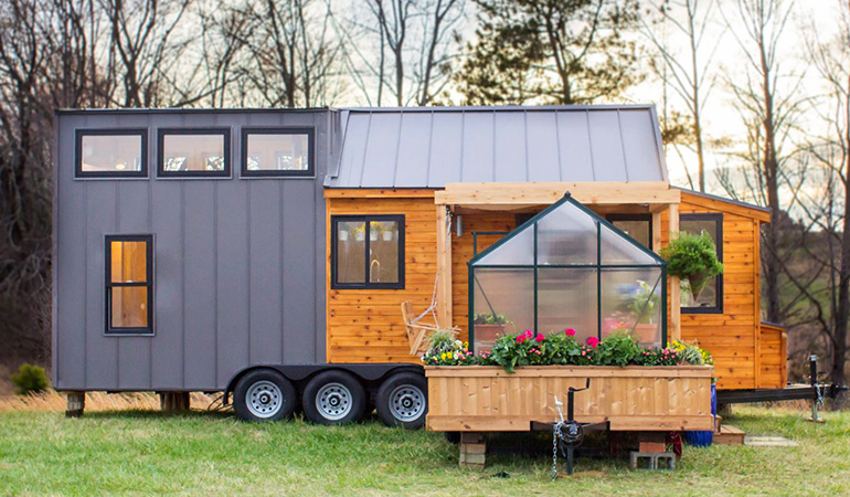 Mobile tiny house with attached greenhouse
