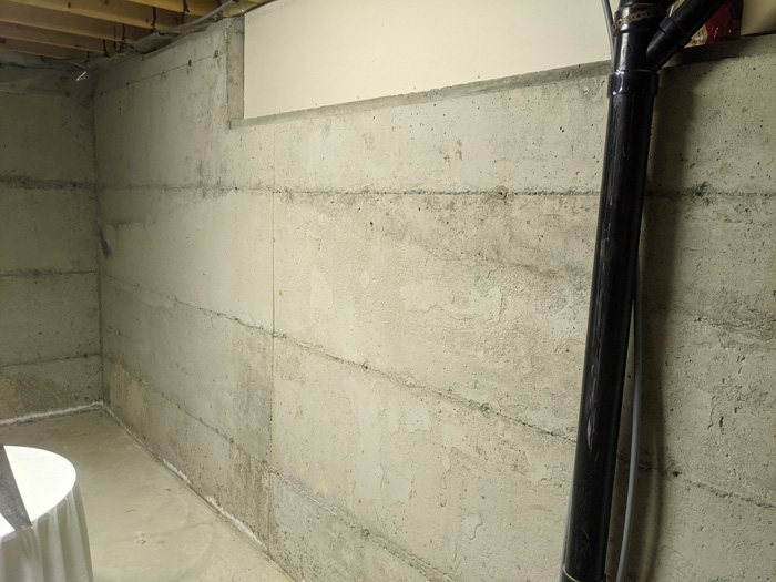 Insulating bare concrete basement walls with rigid foam panels